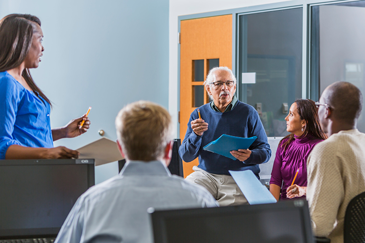Cybersecurity learners in classroom