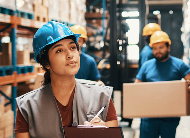 Female supply chain professional managing warehouse