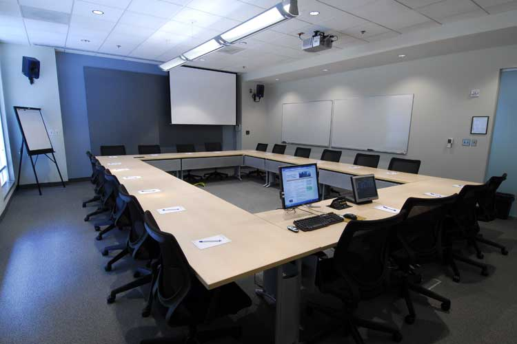 View of computer monitors and projection screens in the conference room