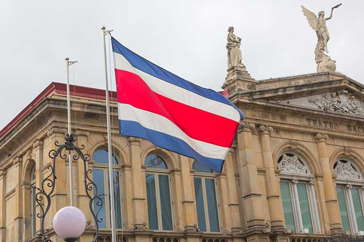 Costa Rica flag flying in front of government building