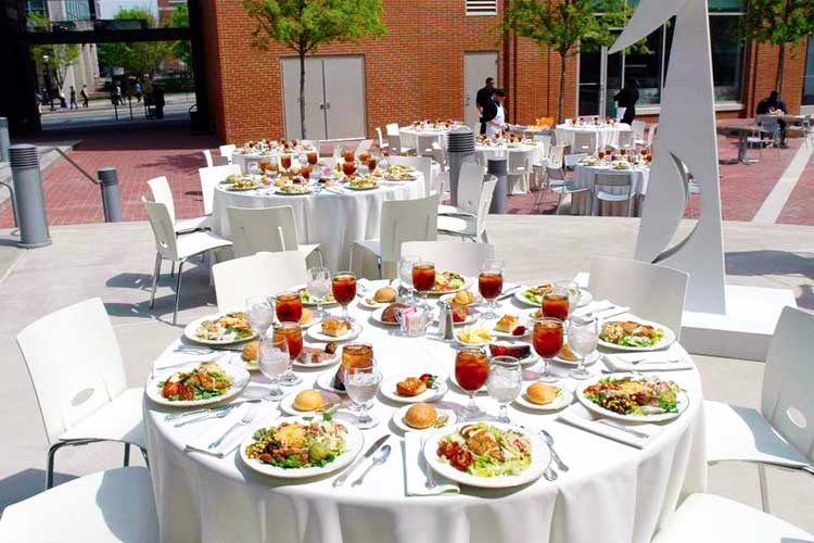 Empty table in the courtyard with plated food displayed