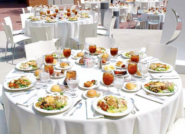 Empty round table with plated food displayed