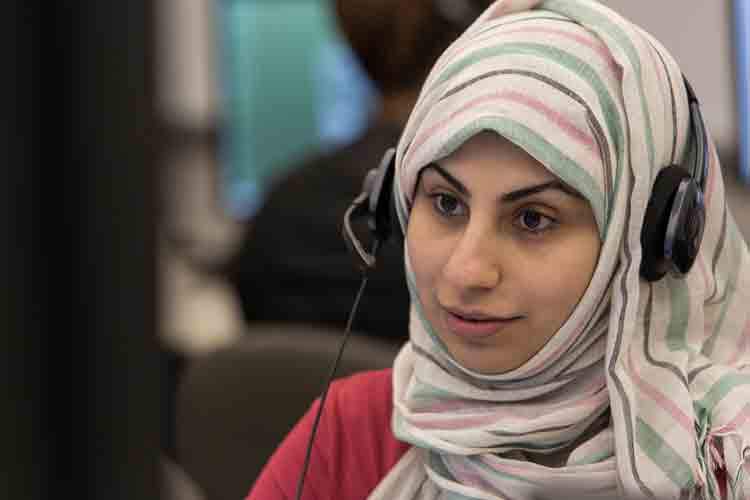 English as a Second Language learner using a headset