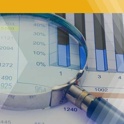 Magnifying glass over financial statements