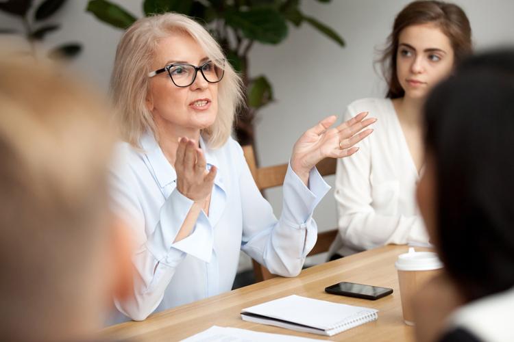 Woman leader addressing meeting