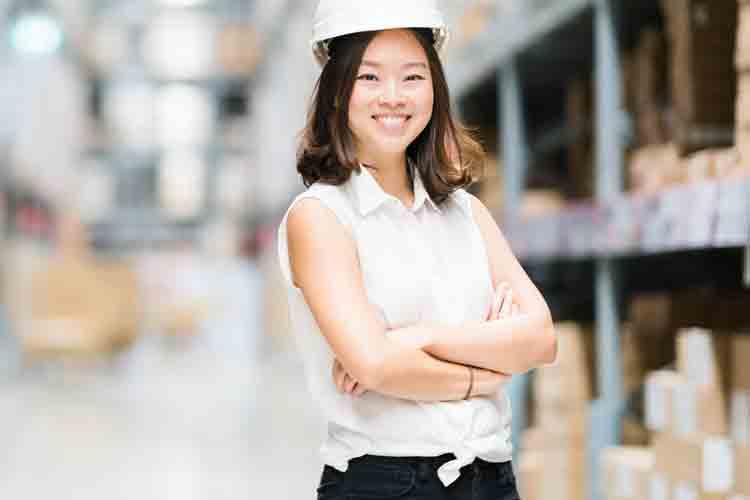 Logistics profession wearing hard hat in warehouse