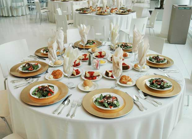 Empty room of round tables with preset meals