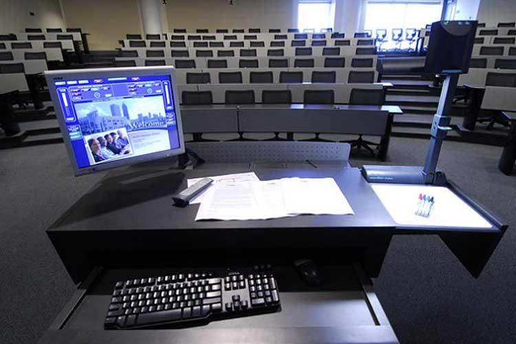 Desktop computer display overlooking empty amphitheater