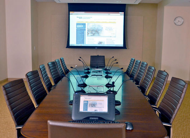 Empty conference room with presentation displayed on project screen
