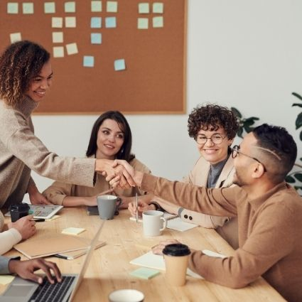 Coworkers collaborating together in office