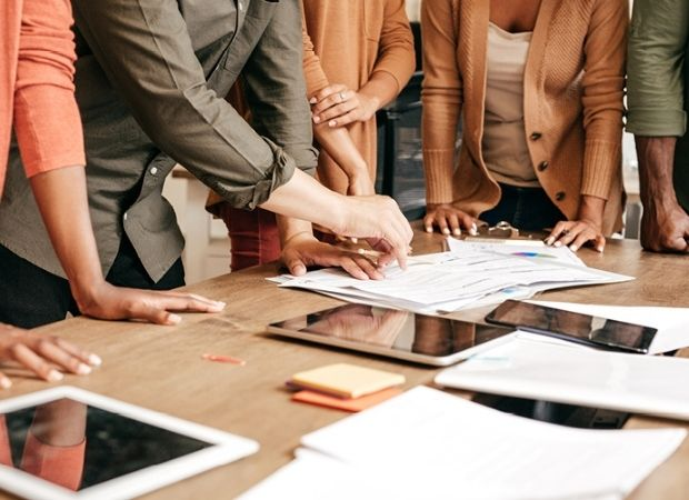 Marketing professionals collaborating around conference table