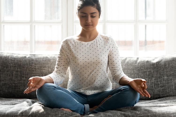 Adult professional taking meditation break on floor