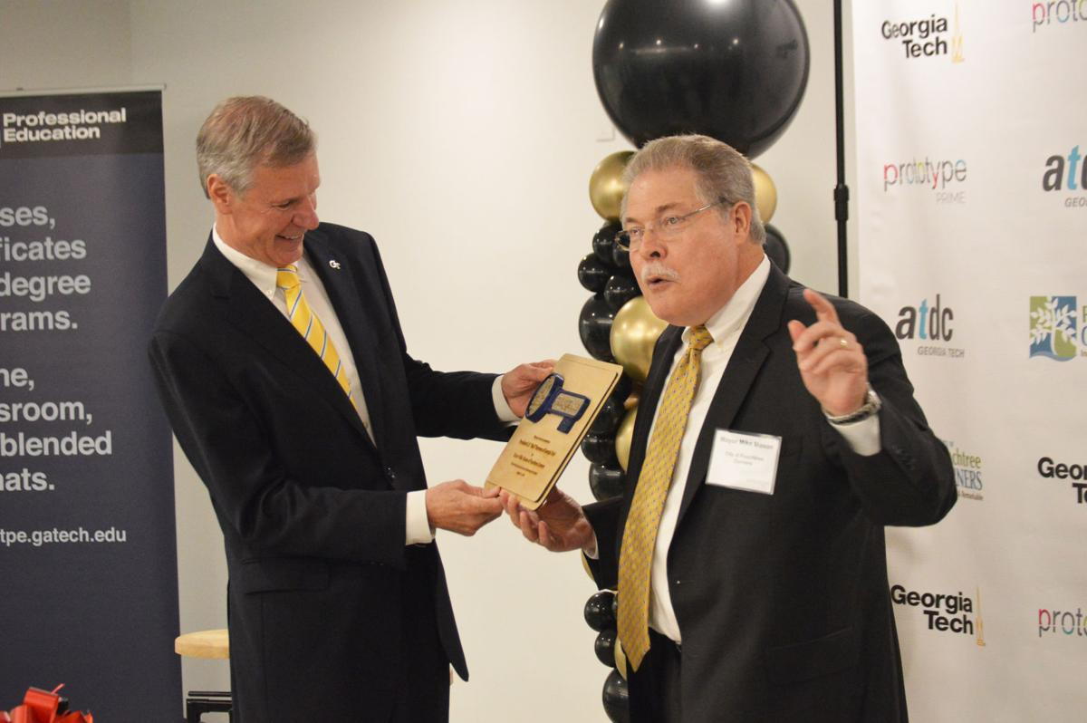 Georgia Tech president Bud Peterson presented key to Peachtree Corners by mayor Mike Mason
