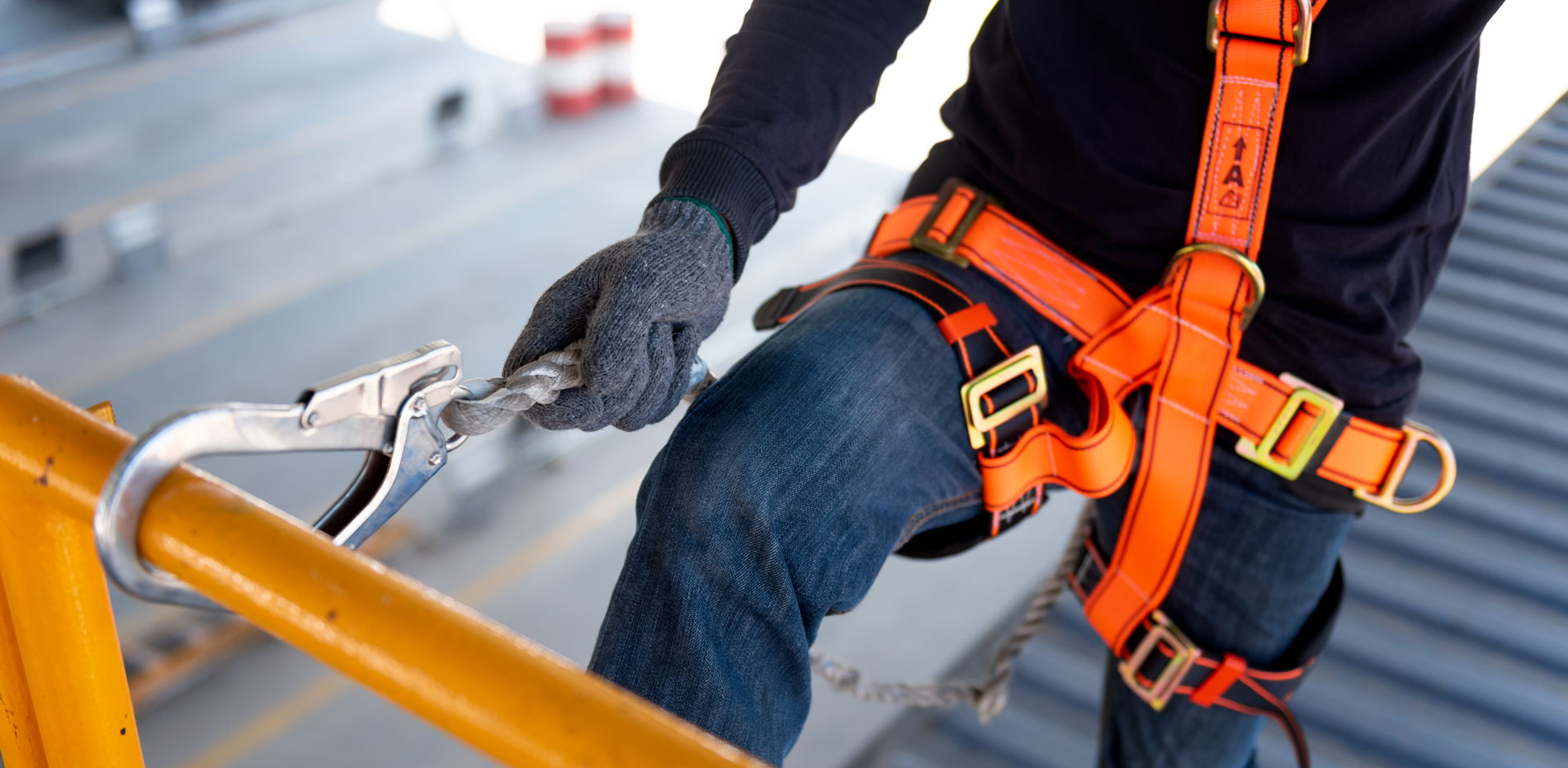 Construction worker using safety harness and safety line on a construction site project