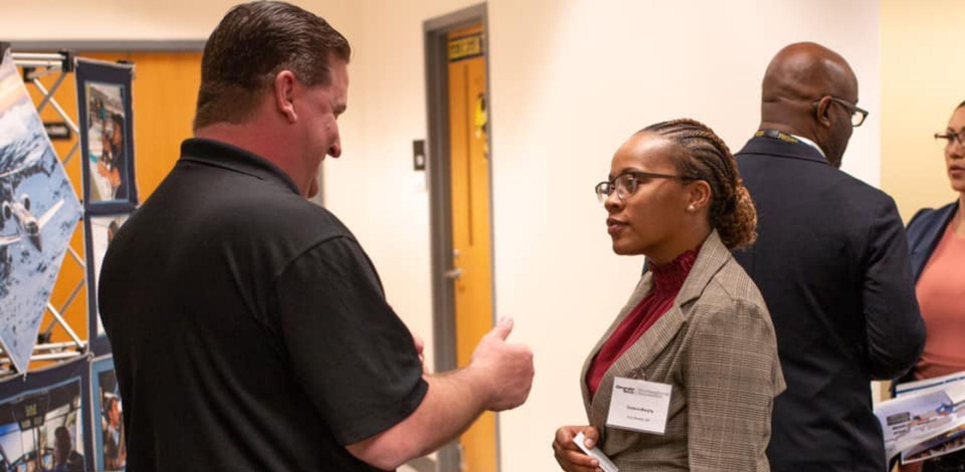 Veteran at career fair talking to potential employer