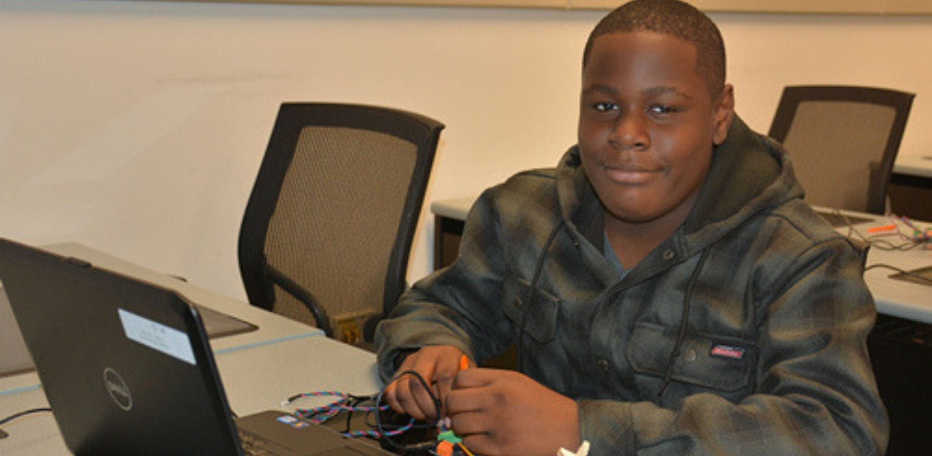 K-12 student working on robotic project