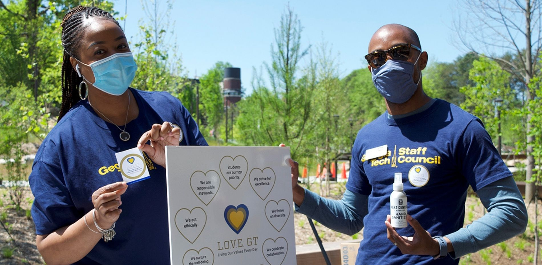 Georgia Tech employees holding up the nine organizational values on a poster board