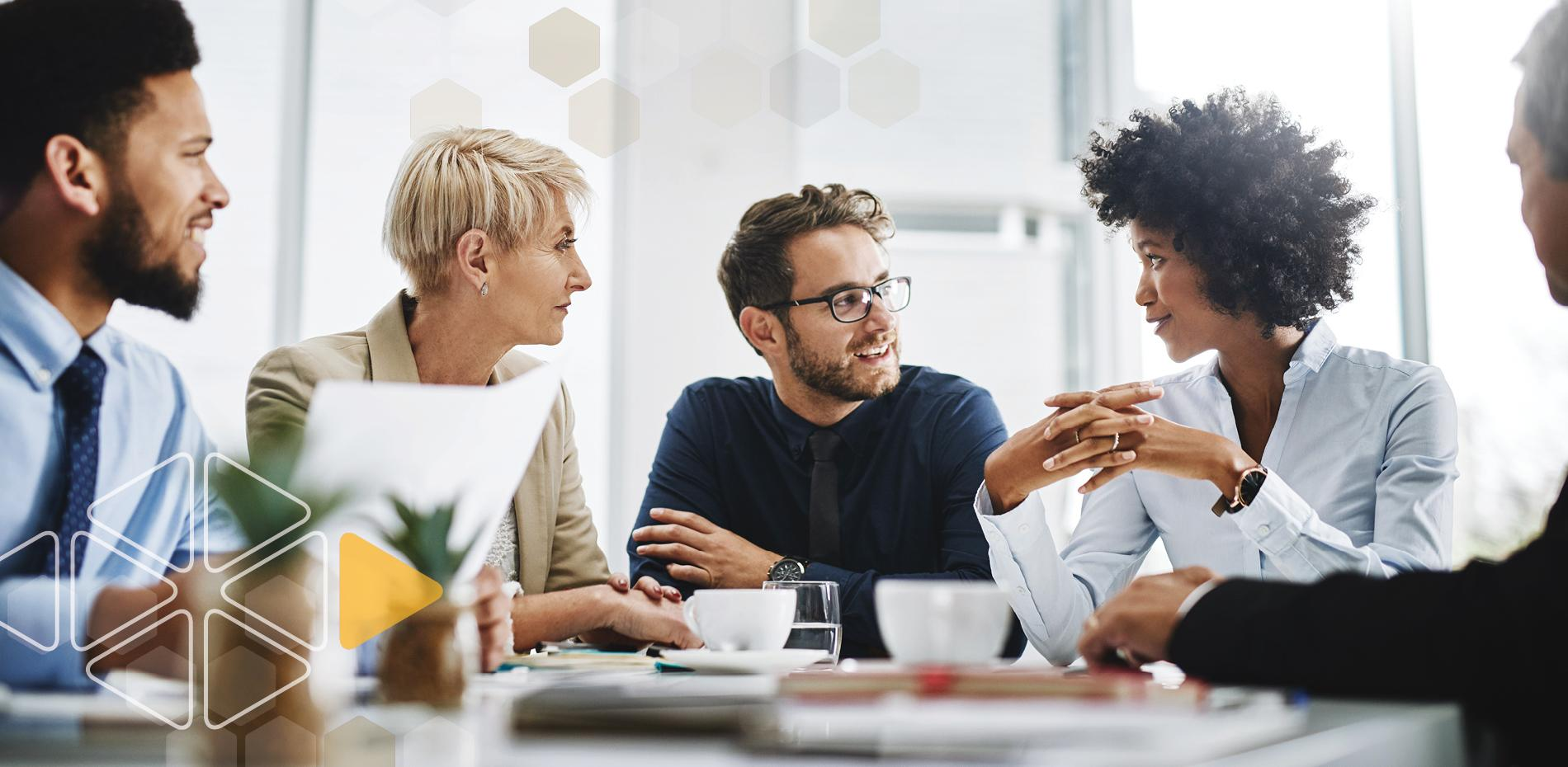 Employees meeting around table to discuss workplace values