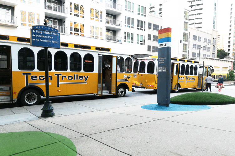 Tech Trolleys parked in front of Global Learning Center
