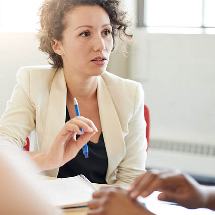 Female professional having candid conversations with team members