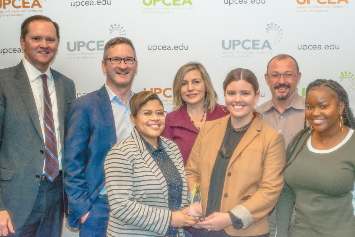 GTPE Marketing Team poses with UPCEA President after winning Best in Show