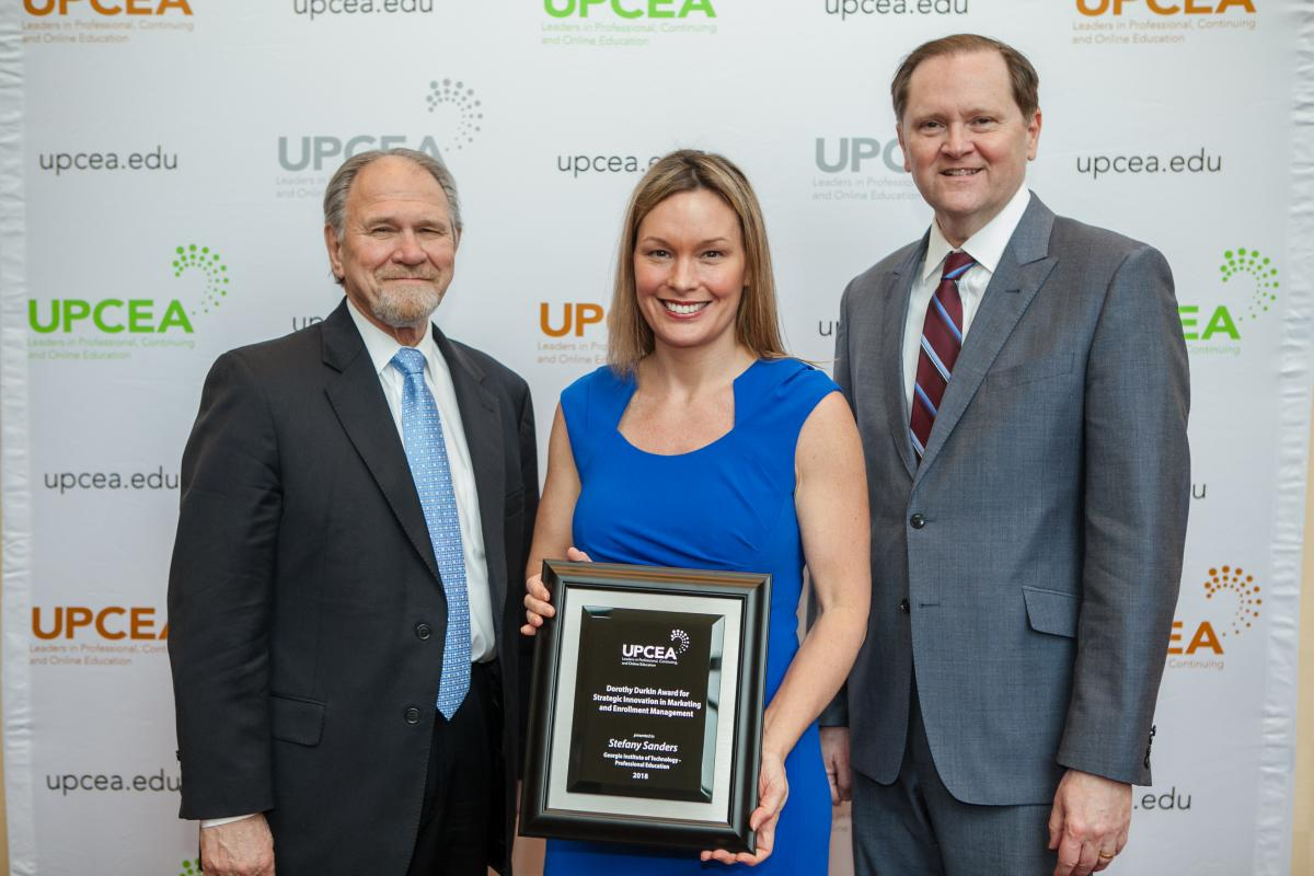 Stefany Sanders poses with Dorothy Dunkin Award and UPCEA President