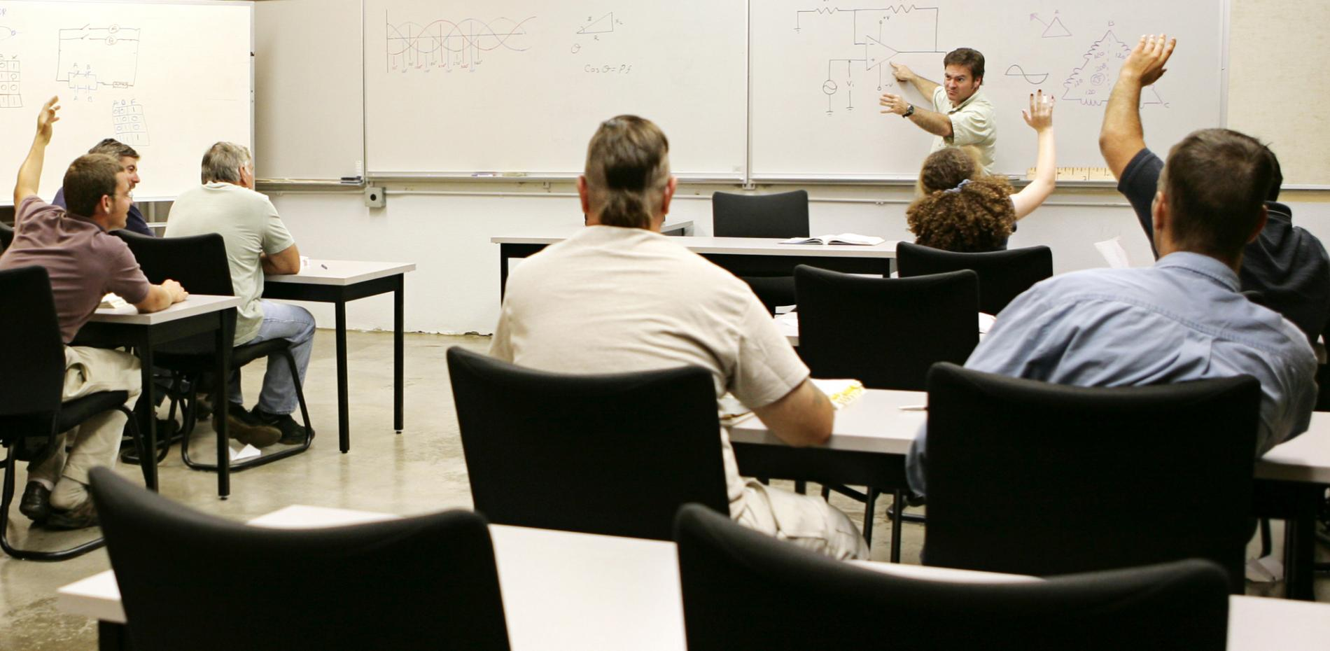 Instructor teaching to a classroom of students