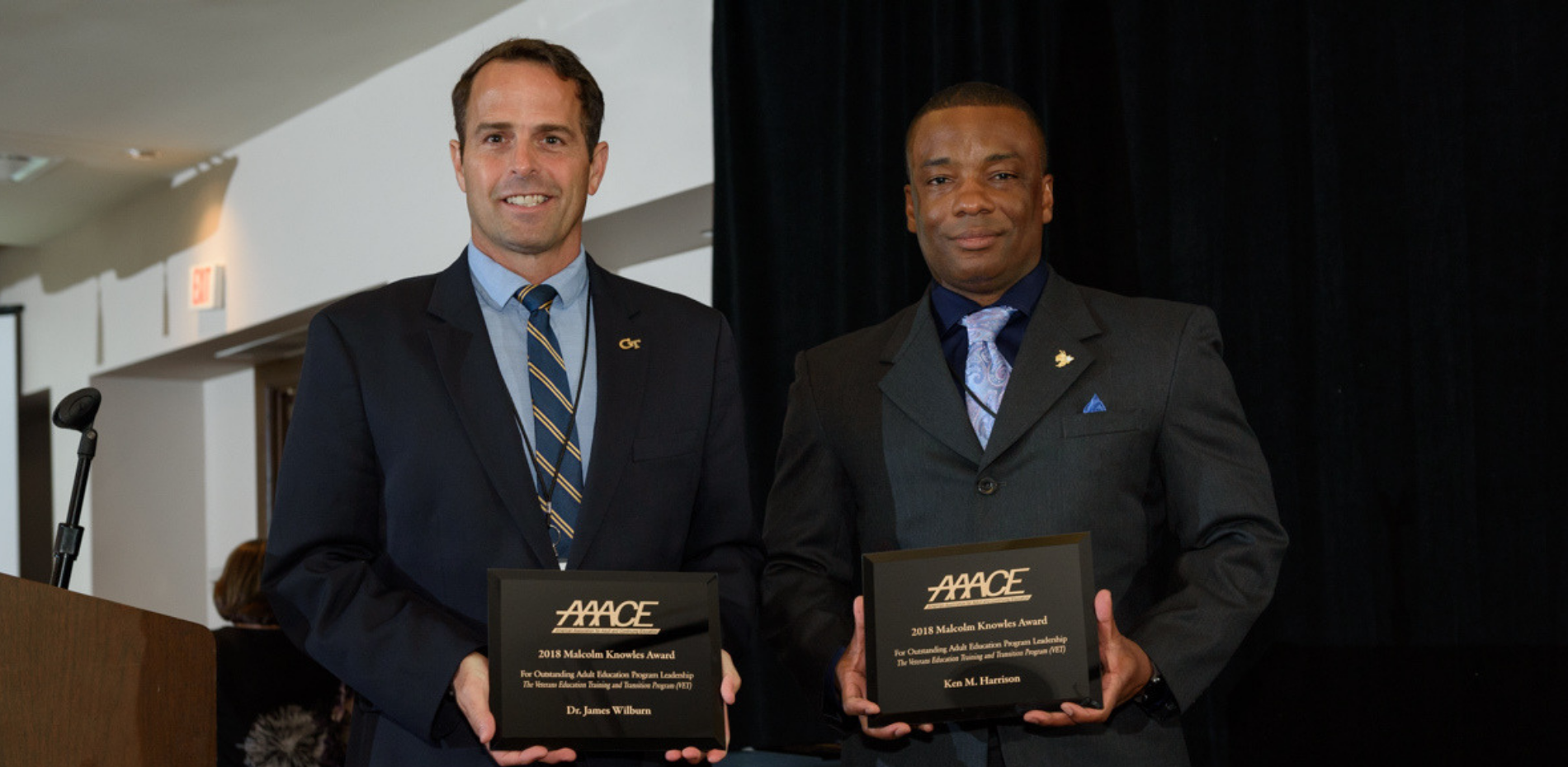 James Wilburn and Ken Harrison standing with award plaques
