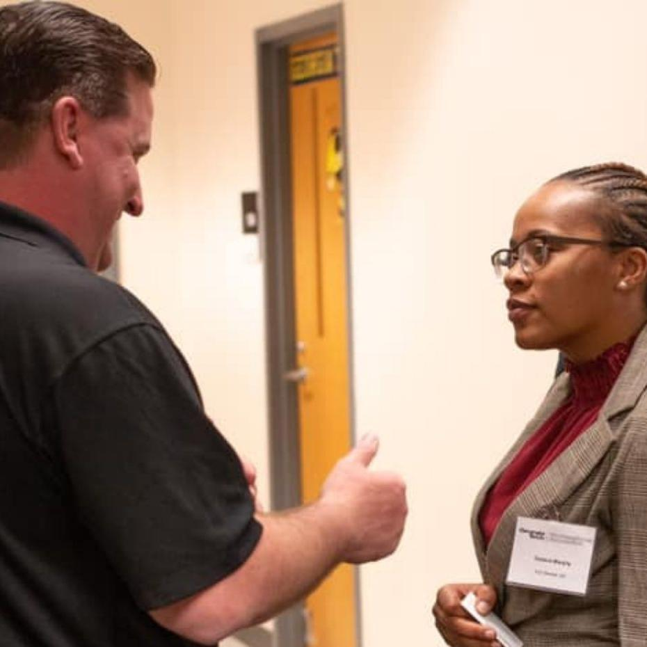 Veteran at career fair talking to potential employer